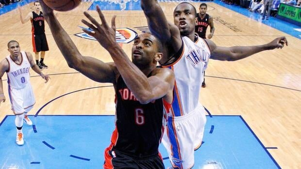 Toronto Raptors forward Alan Anderson (6) shoots in front of Oklahoma City Thunder forward Serge Ibaka during a game on April 8, 2012.