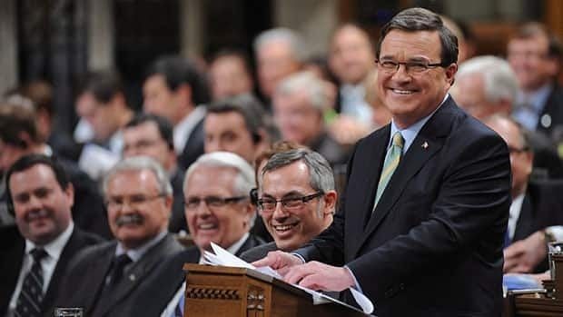 Finance Minister Jim Flaherty presents the federal budget in March, with some of the many ministers whose departments are affected by the budget implementation bill in the background.