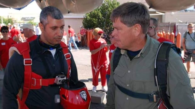 Thunderstorms ended an attempt by Iraqi adventurer Fareed Lafta, left, and Bend, Ore., gas station owner Kent Couch to fly to Montana from Oregon in tandem lawn chairs floating beneath helium-filled balloons.