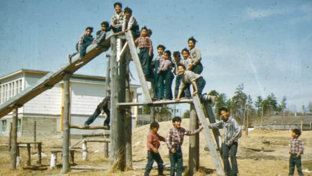 """Children on the playground at Cecilia Jeffrey Indian Residential School in Kenora circa 1957. Newly released documents include a report on the """"experimentation and treatment of ear disease"""" among 165 students in the 1950s."""