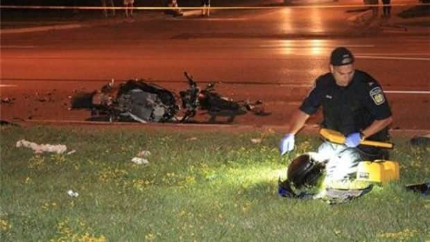The wreckage of a motorcycle remains on the scene of a fatal collision in Brampton