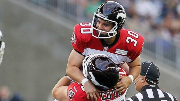 Calgary Stampeders' Rene Paredes, top, and Rob Cote celebrate Paredes' record making field goal kick during the first half of their CFL game against the Winnipeg Blue Bombers on July 26. Now at 36, Paredes will try to extend the streak against the Lions this weekend.