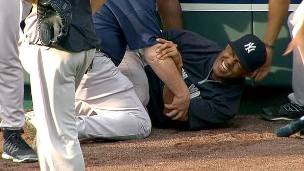 New York closer Mariano Rivera grimaces in pain on the warning track in Kansas City after suffering his pregame injury.