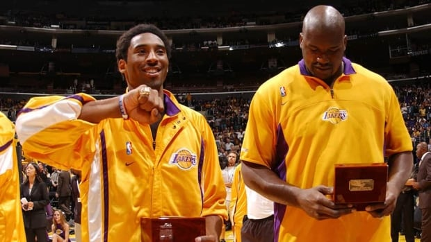Los Angeles Lakers star Kobe Bryant, left, is seen here with teammate Shaquille O'Neal, after receiving his Championship ring for the Lakers' title win in 2000. That ring was one of the items sold by Bryant's parents in an auction that concluded on Saturday.