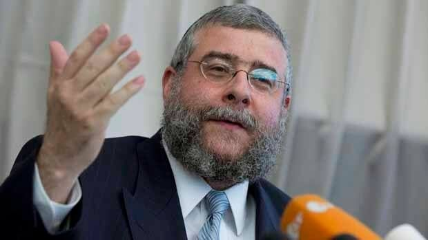 Rabbi Pinchas Goldschmidt, president of the Conference of European Rabbis, gestures during a news conference in Berlin while condemning a German court ruling that circumcising young boys for religious reasons amounts to bodily harm, even if parents agree to it.
