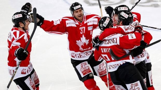 Team Canada's Derrick Walser, right, celebrates his goal with teammates Tyler Seguin, left, Patrice Bergeron, Ryan Smyth, and Jason Demers in Davos, Switzerland on Monday. Canada won the final 7-2.