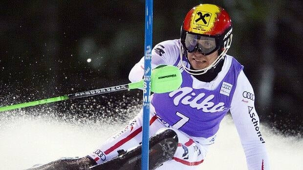 Austria's Marcel Hirscher clears a pole on his way to clock the fastest time during the first run of Tuesday's men's World Cup slalom in Madonna di Campiglio, Italy.