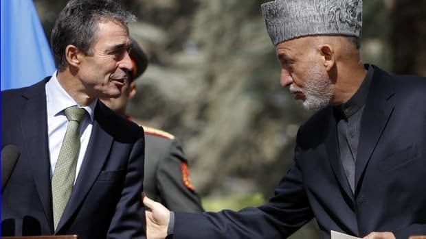 Afghanistan's President Hamid Karzai (right) and NATO Secretary General Anders Fogh Rasmussen attend a joint news conference in Kabul Thursday.