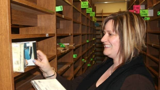 The Inner Sleeve's owner Marilyn Hall finishes packing up the CDs in the CBC music library Wednesday.