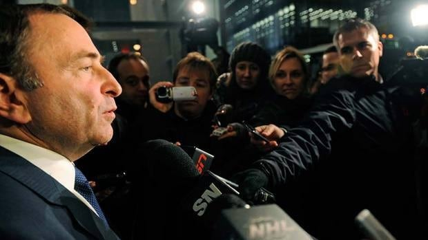 NHL Commissioner Gary Bettman has been speaking to large media scrums in front of the league office for months now, such as here in November. On Monday, he was joined by a street full of New Year's Eve revellers.