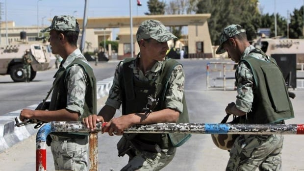 Egyptian army soldiers guard the country's border crossing with Gaza. The border post came under attack Sunday, with Egypt blaming Islamist militants.
