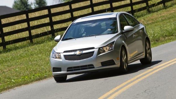 A 2012 Chevrolet Cruze LT drives in Haymarket, Virginia, in this photo provided by GM. The company announced Friday that it is recalling 300,000 of the compact cars because of an issue with power-assisted brakes.