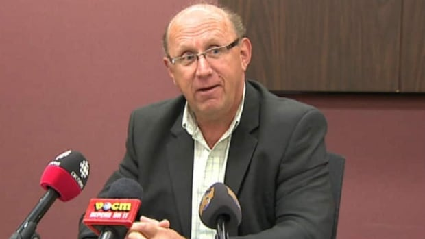 Bob Smart is seen speaking with reporters at an August 2013 news conference.