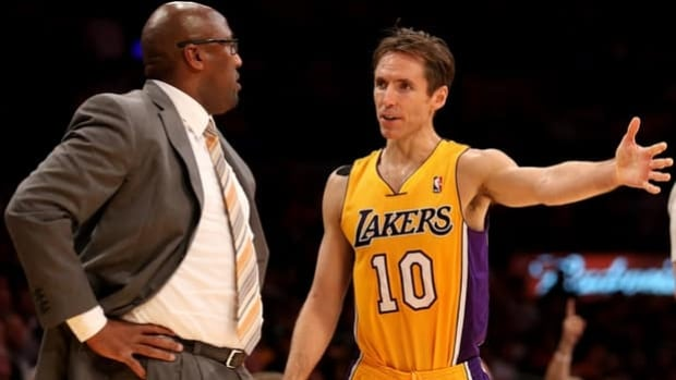 Victoria's Steve Nash, right, confers with Lakers head coach Mike Brown on Tuesday night.