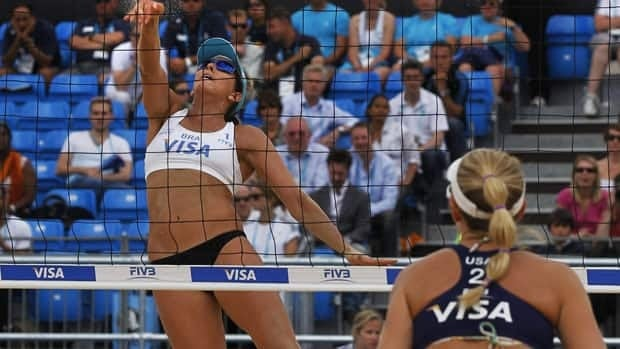 Female beach volleyball athletes will now be allowed to wear shorts and sleeved tops at the Olympics in London 2012.