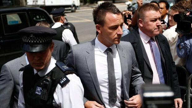 Former England soccer captain and Chelsea player John Terry, centre, arrives at Westminster Magistrates Courts in London, Friday.