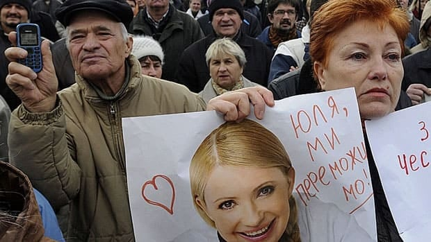 A supporter of the Ukrainian Opposition party carries a poster depicting jailed politician Yulia Tymoshenko at a rally outside the Central Elections Commission building in Kyiv Nov. 6. Ukraine's opposition parties are protesting alleged election fraud in last month's parliamentary election.