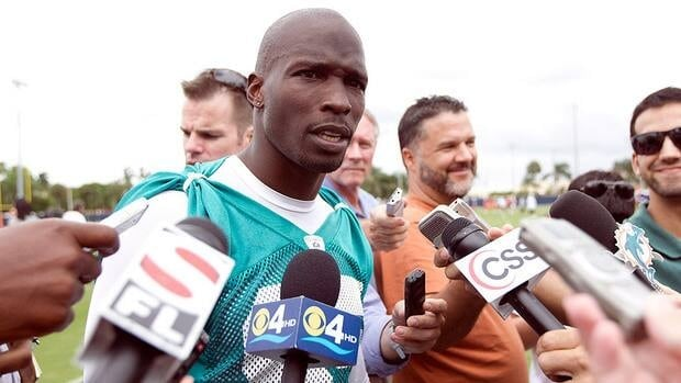 Miami Dolphins player Chad Johnson talking to the media after NFL practice.
