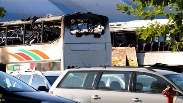 Buses caught in a deadly explosion sit at the airport outside the Black Sea city of Burgas, Bulgaria, on Wednesday. One of the buses was carrying young Israeli tourists.