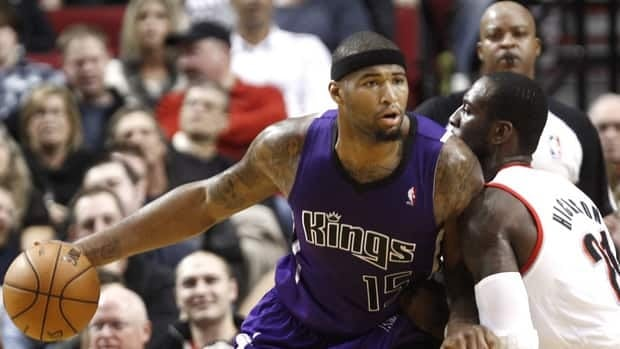 Sacramento Kings centre DeMarcus Cousins posts up against Portland Trail Blazers centre J.J. Hickson during a game between the two teams on Dec. 8.