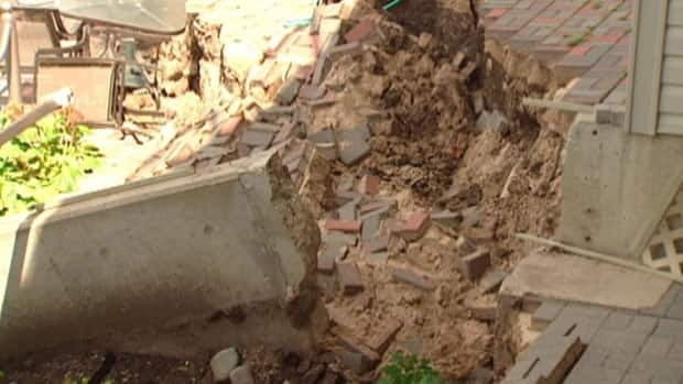 A backyard in Saskatoon is a mess after soil shifted.
