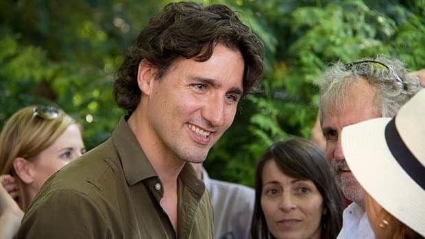 Liberal Leader Justin Trudeau talks with supporters in Nelson, B.C., before heading off on hike with his family to Kokanee Lake.