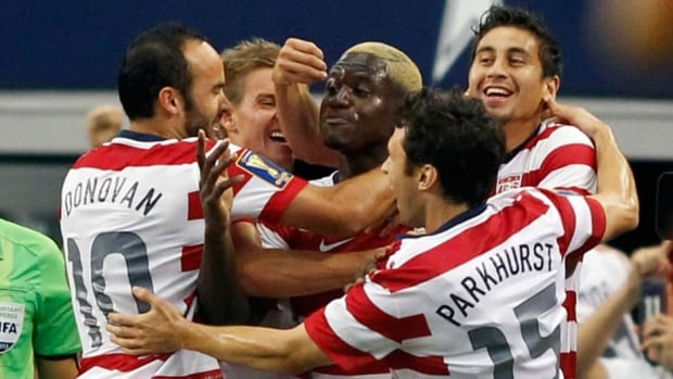 (L-R) Landon Donovan, Eddie Johnson and Michael Parkhurst of the U.S. celebrate Johnson's goal against Honduras during their CONCACAF Gold Cup soccer match Wednesday in Arlington, Texas.