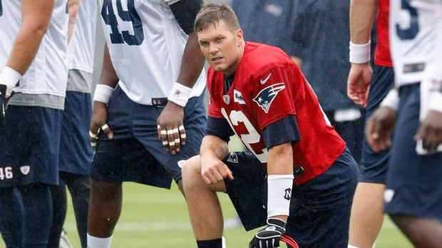 New England Patriots quarterback Tom Brady limped off the practice field on Wednesday with a knee injury.