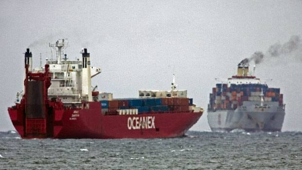 Container ships pass on the outer part of Halifax harbour near Herring Cove, N.S. in 2010. Canadian merchandise exports fell in January, shrinking the trade surplus to $2.9 billion.