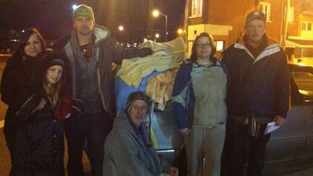 Members of the Sudbury Coalition Against Poverty get ready to hand out donated blankets to those in need.