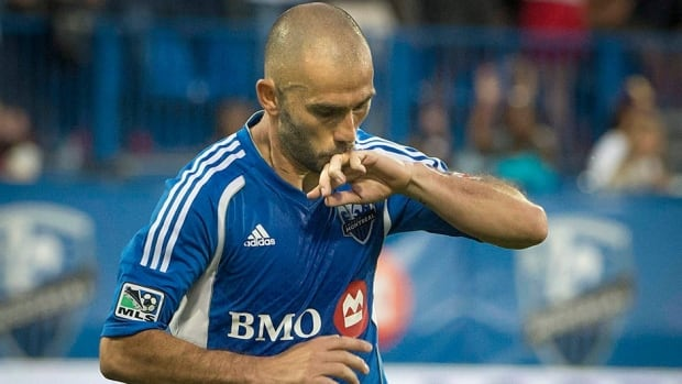 Montreal Impact's Marco Di Vaio kisses his wedding ring after scoring on D.C. United during first half MLS action in Montreal on Saturday. The Impact went on to win in a match that saw both coaches ejected.