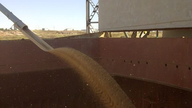 Grain flows into the hold of a ship at the Port of Churchill.