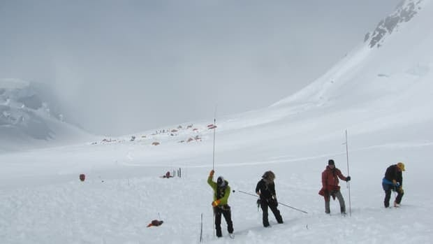 Rescue workers search a debris field after an avalanche hit the West Buttress route of Mount McKinley in Alaska in June 2012.