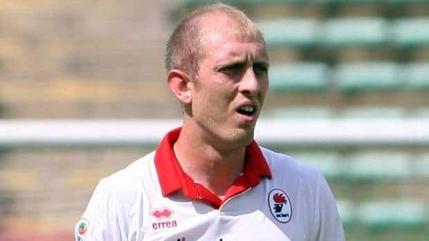 In this May 15, 2011 file photo, Bari's defender Andrea Masiello reacts during the Serie A Bari vs Lecce soccer match. Masiello was arrested Monday and questioned for hours on Wednesday about a match-fixing scandal involving his former team.
