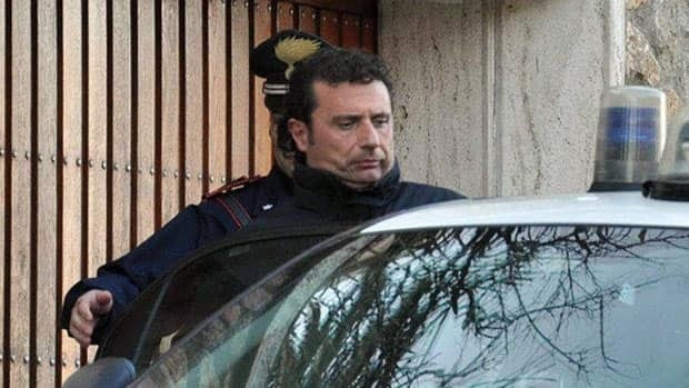 The captain of the luxury cruiser Costa Concordia, Francesco Schettino, is shown entering a Carabinieri car in Porto Santo Stefano, Italy on Saturday. In audio released Tuesday, the captain is heard making excuses when repeatedly ordered by the Italian coast guard to reboard his ship, which ran aground off Italy's Tuscan coast.