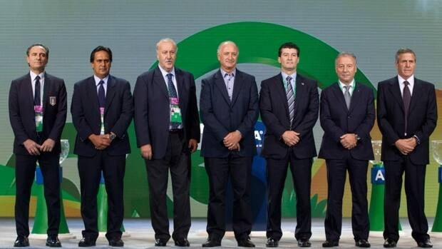 National soccer coaches pose for a picture ahead of the official draw for the FIFA 2013 Confederations Cup Brazil in Sao Paulo, Brazil, Friday, Nov. 30, 2012.
