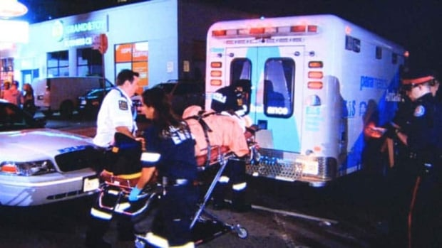 Paramedics transport a man injured at Corbra nightclub after a shooting last Friday. Two Toronto men are now facing multiple charges.