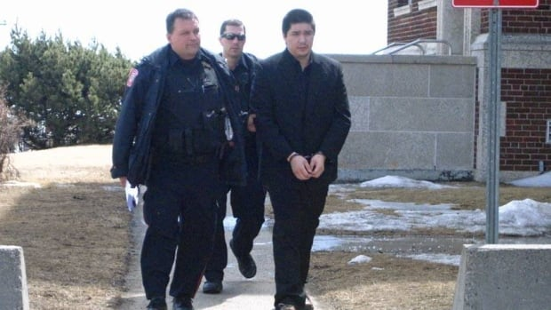Leif Hobson, right, walks from a Thunder Bay court house in this CBC file photo taken earlier this year.