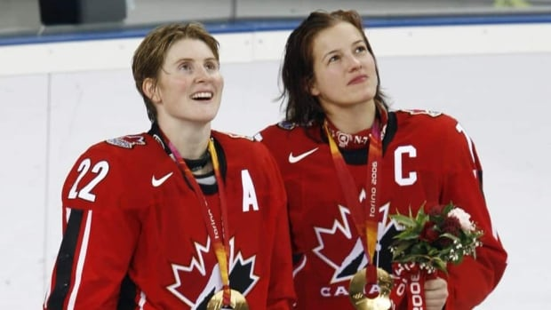 Canada's Hayley Wickenheiser, left, and team captain Cassie Campbell-Pascall took gold together in women's hockey at the Turin 2006 Winter Olympic Games in Italy.