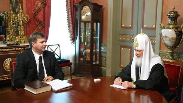 Patriarch Kirill of the Russian Orthodox church, right, meets with Russian Justice Minister Alexander Konovalov in Moscow. This 2009 photo, posted on the Russian Orthodox church's website, caused a scandal when the site's editors first erased the patriarch's wristwatch.