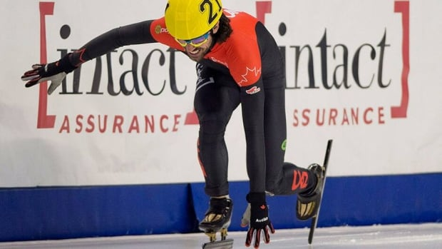 Charles Hamelin limps off the ice following a collision with Francois-Louis Tremblay during the semifinal of the men's 1,000-metre race at the 2014 Canadian short-track speedskating team selections in Montreal on Sunday.