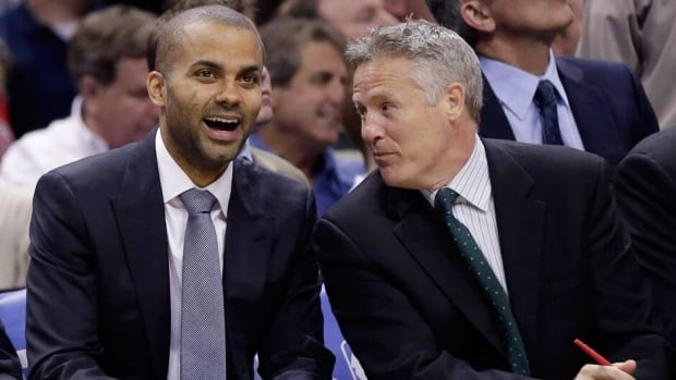 Brett Brown, right, shown in this file photo sitting with Spurs guard Tony Parker, has reportedly been offered the Philadelphia 76ers' long-vacant coaching job.
