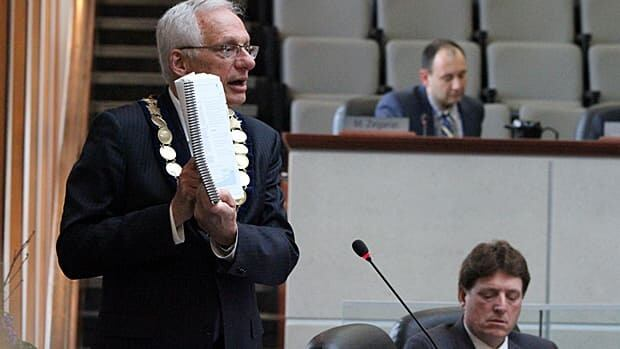 Mayor Bob Bratina holds up the city's Rapid Ready transit plan during a debate last April. Coun. Brian McHattie, who is running for mayor in this fall's election, has sent a letter to Premier Kathleen Wynne in favour of LRT. Bratina says he should have done it as a candidate and not a councillor.