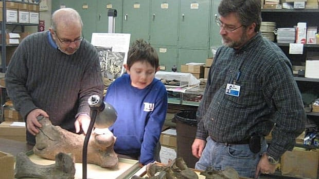 University of Manitoba researcher Haskel Greenfield (left) and his son went down to the Cleveland Museum of Natural History after a request from curator Brian Redmond (right), who wanted to know the origin of scratches in the thigh bone of a giant ground sloth.