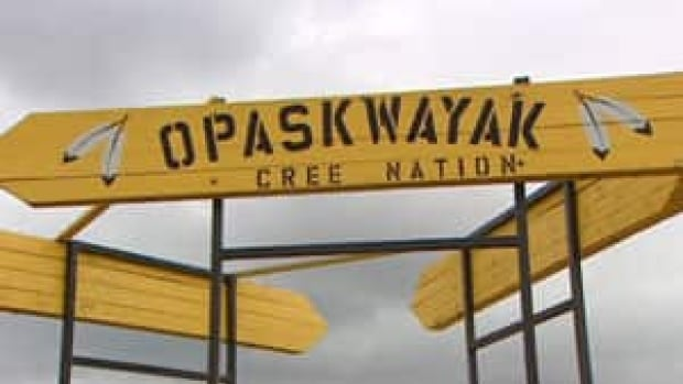 The Opaskwayak Cree Nation is facing a $6.2 million net debt in 2014, and band members are protesting reserve leadership's decision on how to eliminate it.