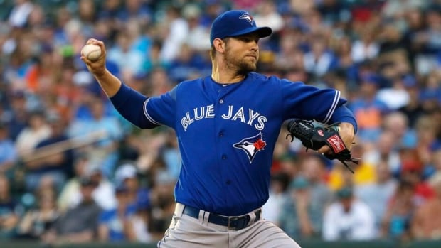 Toronto Blue Jays starting pitcher Josh Johnson felt tightness in his right forearm while playing catch a day before he was scheduled to start against the Boston Red Sox.