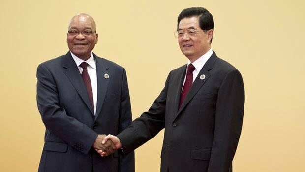 South African President Jacob Zuma, left, shakes hands with his Chinese counterpart, Hu Jintao, at the 5th Ministerial Conference of the Forum on China-Africa Cooperation held at the Great Hall of the People in Beijing on Thursday.