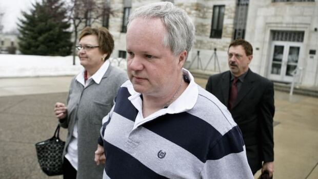 William Melchert-Dinkel, centre, leaves the Rice County Courthouse in Faribault, Minn., on Feb. 17, 2011, with his attorney Terry Watkins, right, and wife, Joyce Melchert-Dinkel, after waiving his right to a jury trial. Melchert-Dinkel was found guilty of aiding the suicides of two people, including a young Canadian woman.