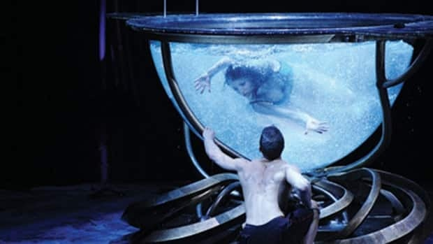 Amaluna features a contortionist in a fish bowl, conjuring an image of female fertility.