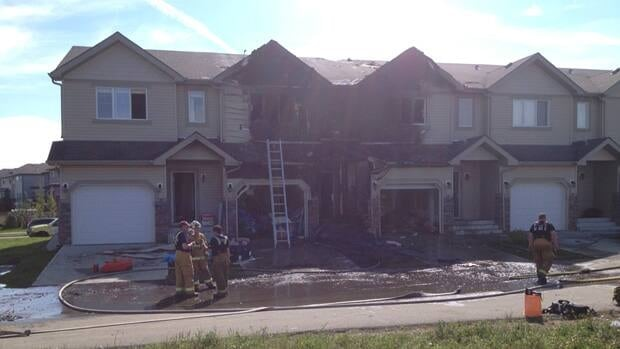 It took crews over an hour to get the flames under control at these Sandstone Estates homes.